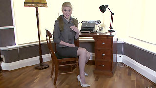 Stylish blonde joking you with regard to her office