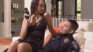 Asian bombshell in erotic lingerie Katsuni rides a cop's dick