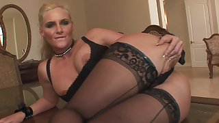Blonde MILF spreading and fingering her juicy holes