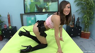 Slender abstruse cutie rides cock close to high heels and stockings