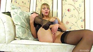 Mature blonde solo MILF model Lizi masturbates in stockings