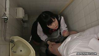 Filthy Japanese partisan Sayaka Aishiro gives a blowjob and tugjob concerning along to toilet