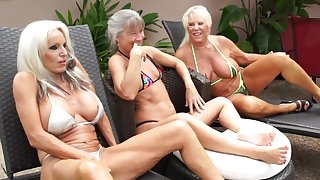 Of age grannies portion BBC in outdoor interracial threesome by the pool