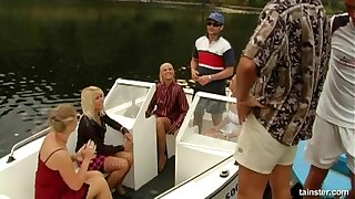 Glamour bitches fucked by two rich dudes on a private Runabout
