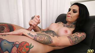Tattooed shemale with bright red lips Gaby Ink is busy with wanking