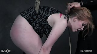 Powered master puts a bootylicious babe in some nice bondage
