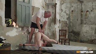 Slim twink endures elderly man's dirty punishment in serious anal BDSM statute