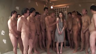 A single Japanese lady is fatiguing to satisfy a dozen of men